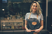 Portrait of Smiling cafeteria owner standing with hands in pocket