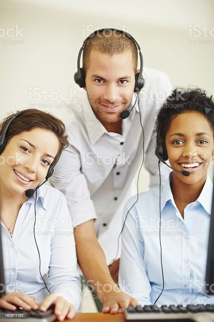 Portrait of smiling call center employees at work royalty-free stock photo