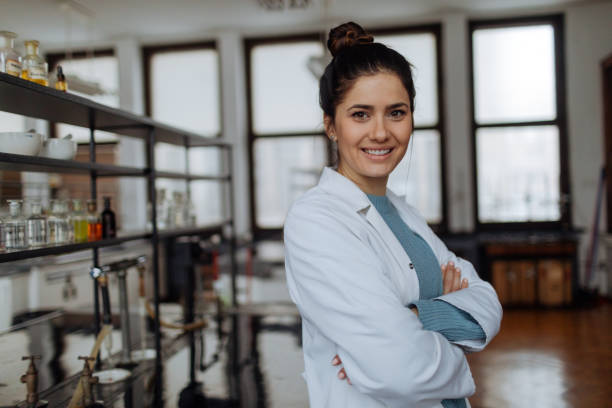 Portrait of smiling chemist Portrait of smiling chemist in laboratory microbiologist stock pictures, royalty-free photos & images