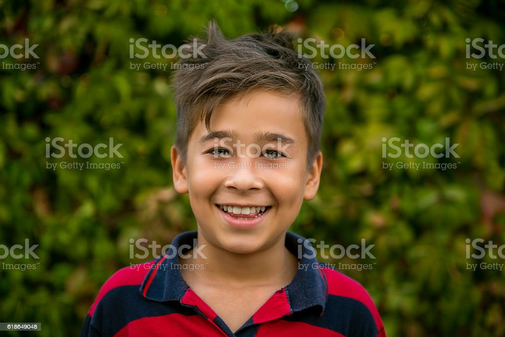 Portrait of smiling child looking at camera in happiness stock photo