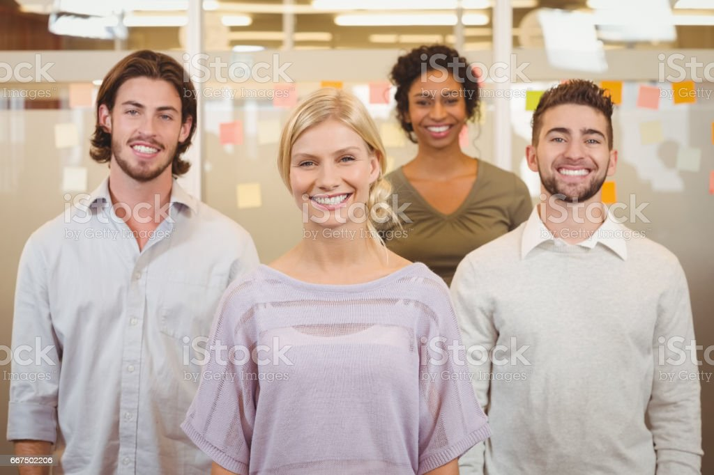 Portrait of smiling colleagues in creative office foto stock royalty-free