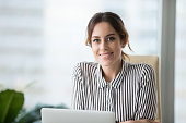 istock Portrait of smiling confident female boss looking at camera 1051453400