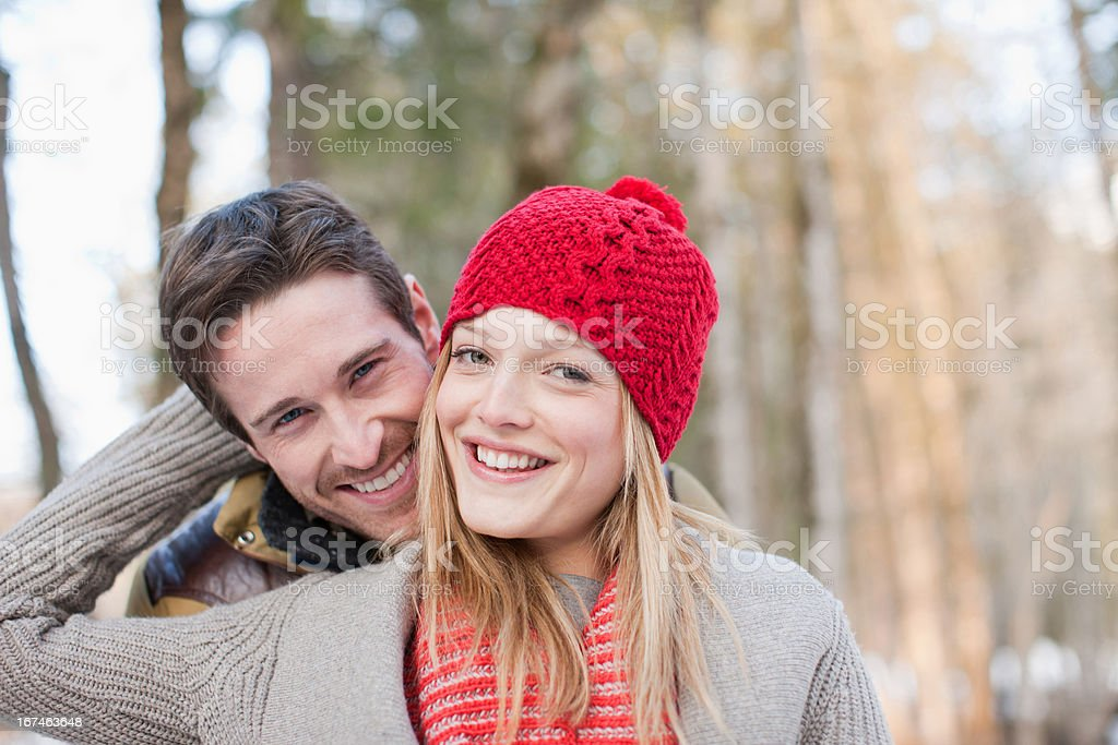 Portrait of smiling couple in snow royalty-free stock photo