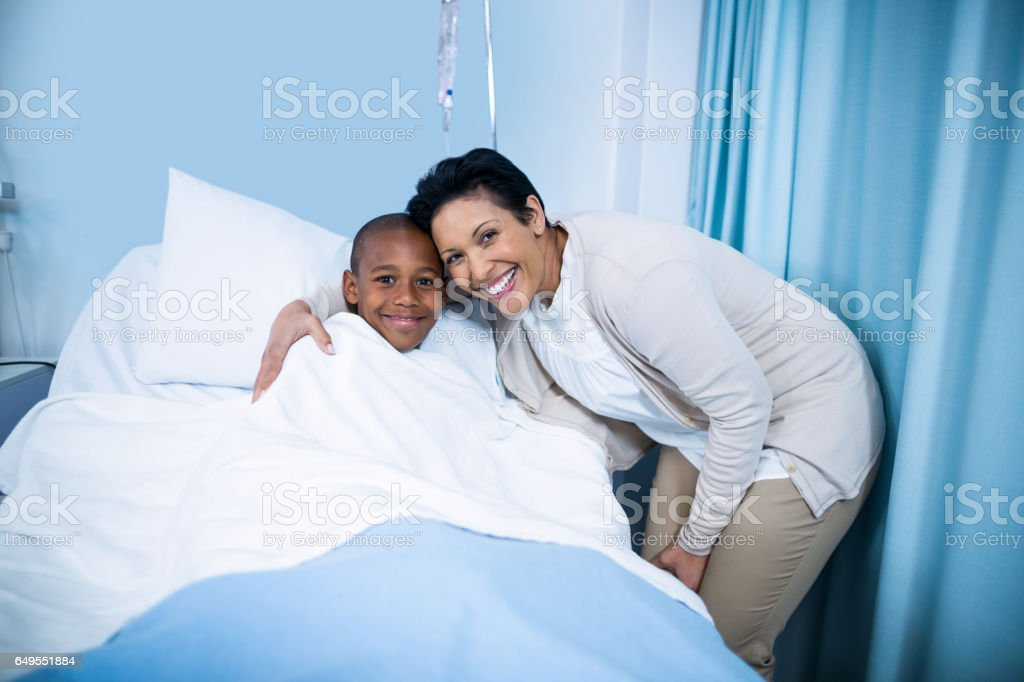 Portrait of smiling doctor and patient stock photo