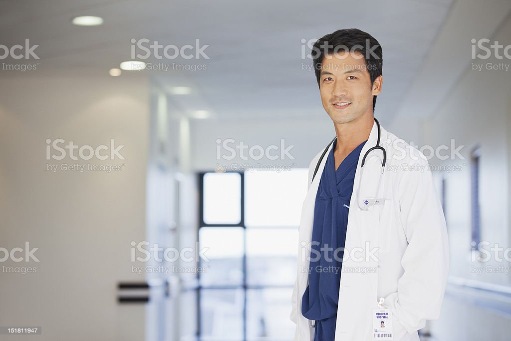Portrait of smiling doctor in hospital corridor stock photo