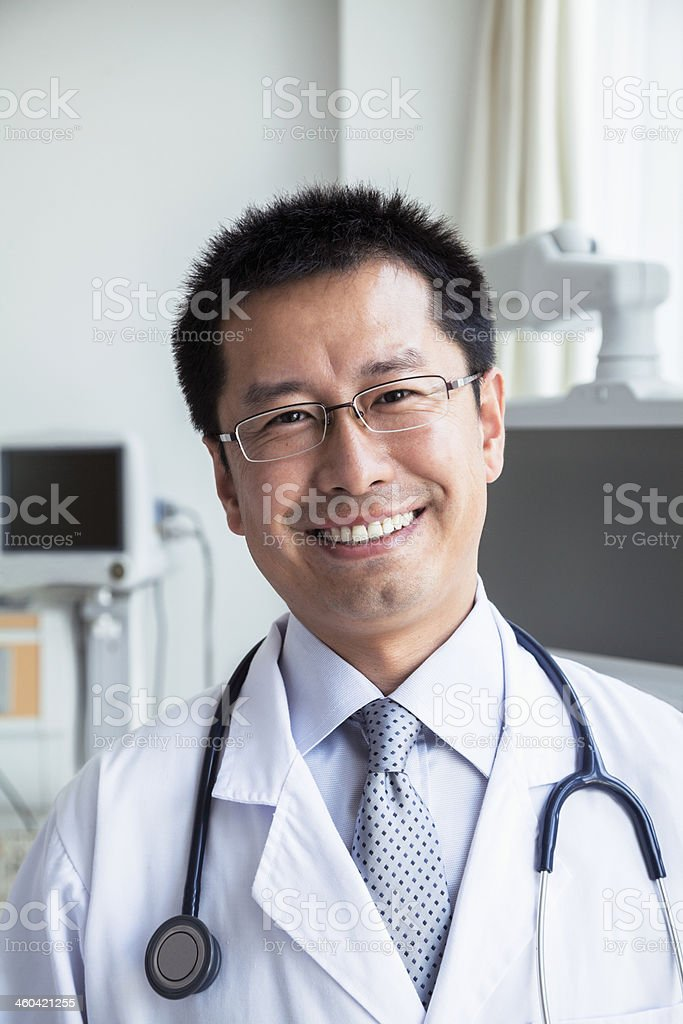 Portrait of smiling doctor with a stethoscope looking at camera stock photo