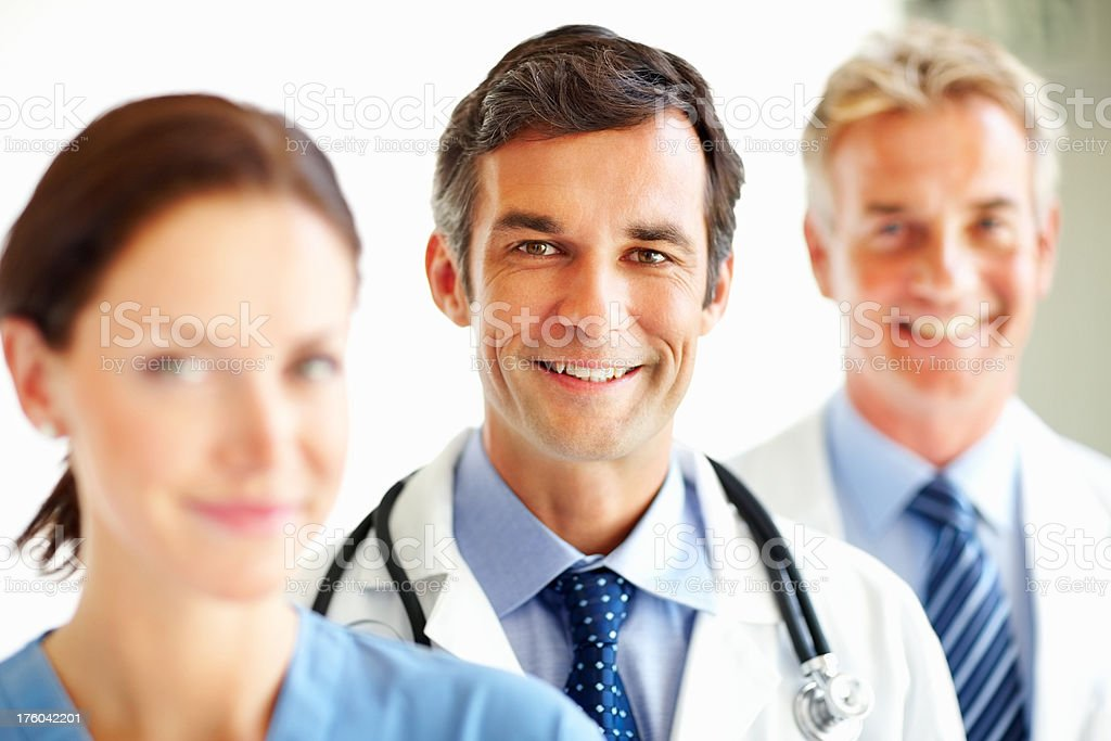 Portrait of smiling doctors standing in a row royalty-free stock photo