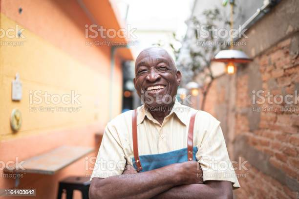 Portrait of smiling elderly waiter looking at camera picture id1164403642?b=1&k=6&m=1164403642&s=612x612&h=u9d ggl1niky vgfedxmmwniqtqrv7o3 ampugky0qw=