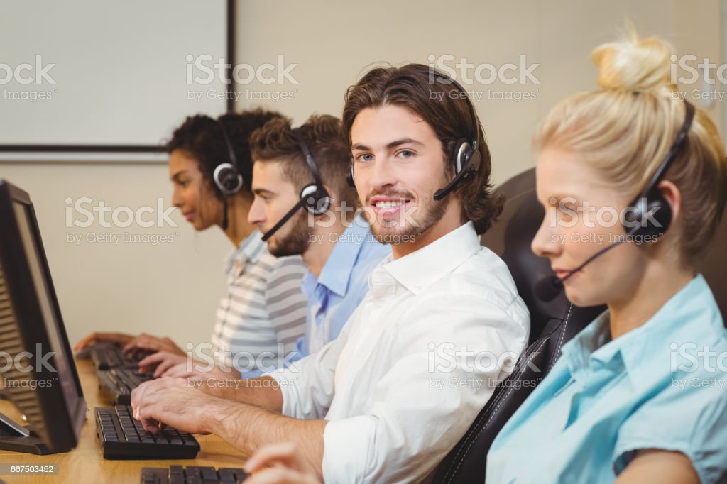 Portrait of smiling executive in call center foto stock royalty-free