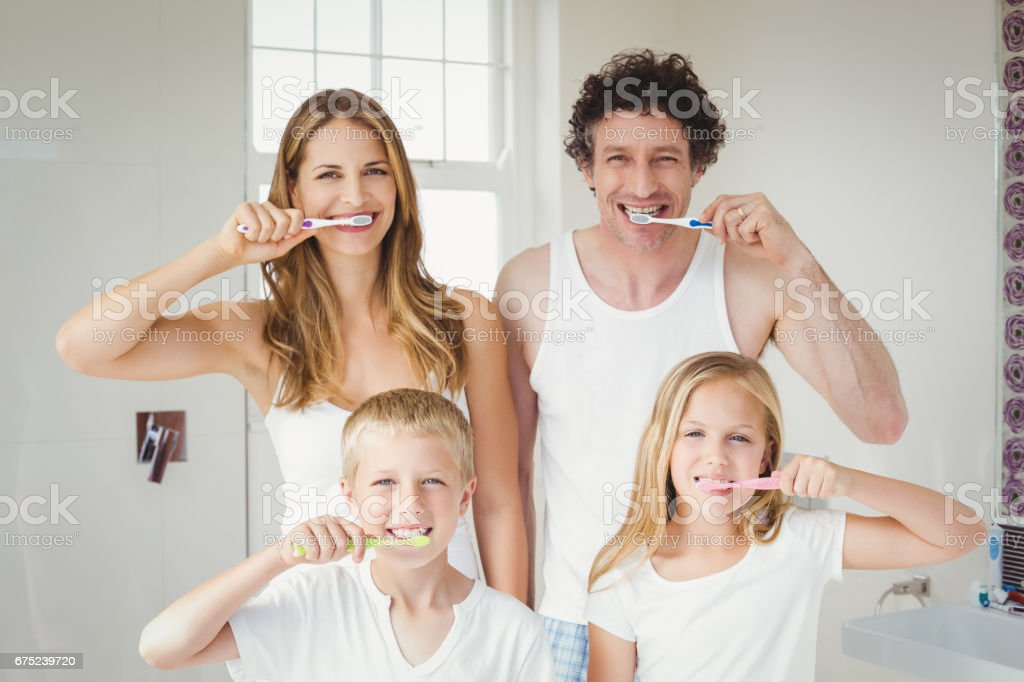 Portrait of smiling family brushing teeth royalty-free stock photo