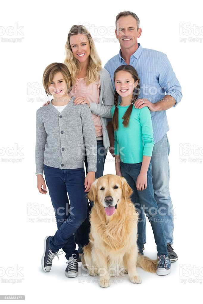 Portrait of smiling family standing together with their dog stock photo