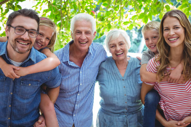 portrait of smiling family with grandparents - multi generation family stock photos and pictures
