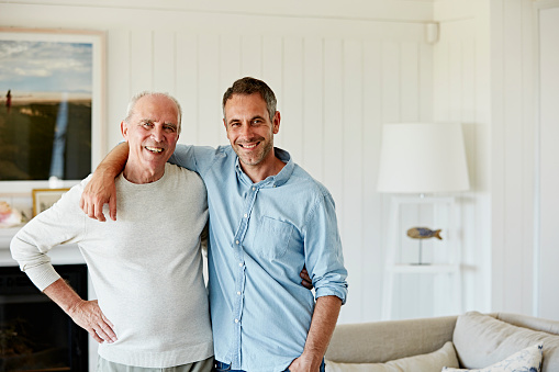Portrait of smiling father and son at home