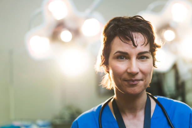 portrait of smiling female doctor in hospital - surgeon стоковые фото и изображения