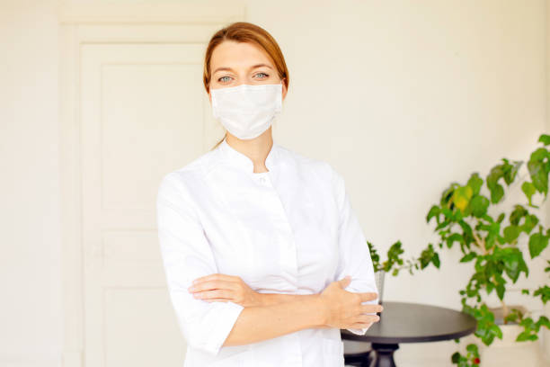 Portrait of smiling female doctor in white office stock photo