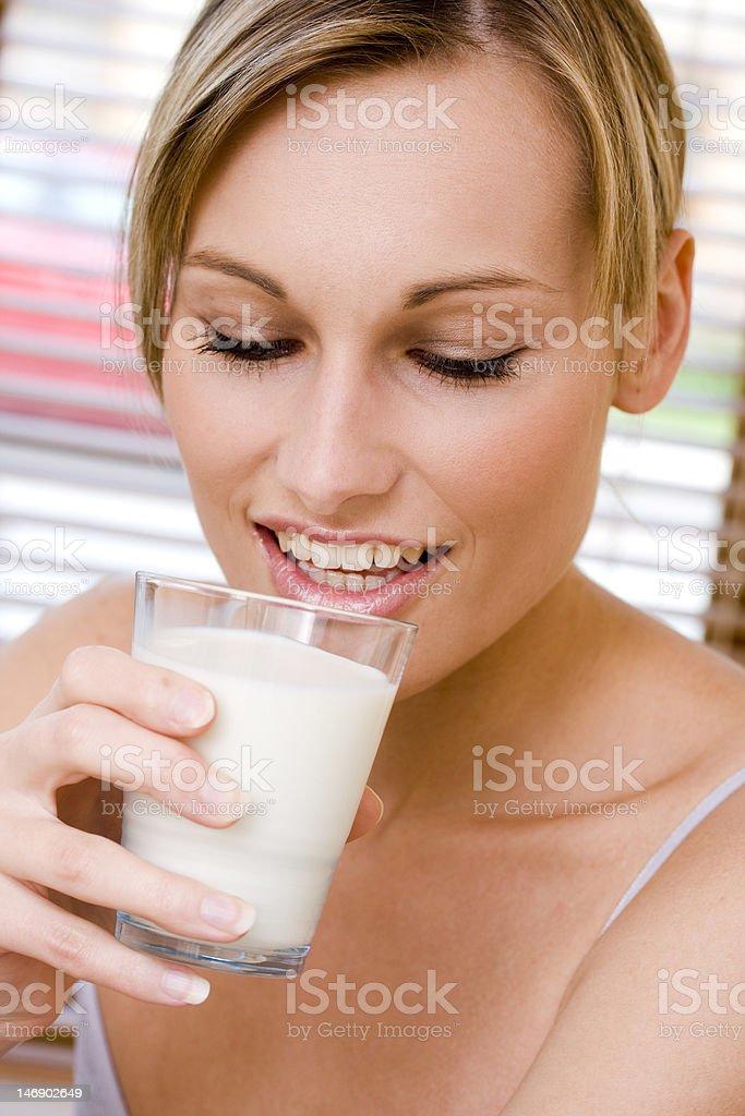 Portrait of smiling female drinking a milk royalty-free stock photo