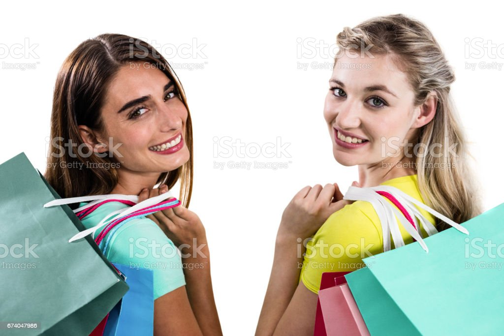 Portrait of smiling female friends holding shopping bags royalty-free stock photo