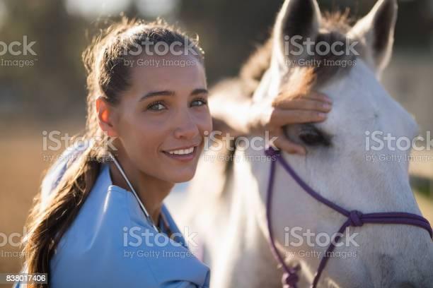 Portrait of smiling female vet checking horse picture id838017406?b=1&k=6&m=838017406&s=612x612&h=omu5nkek uvn2wjmiztlh5fc6asydscrupqqcti0rw0=