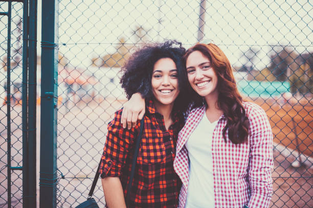 portrait of smiling friends at the schoolyard - beautiful college girl pics stock photos and pictures