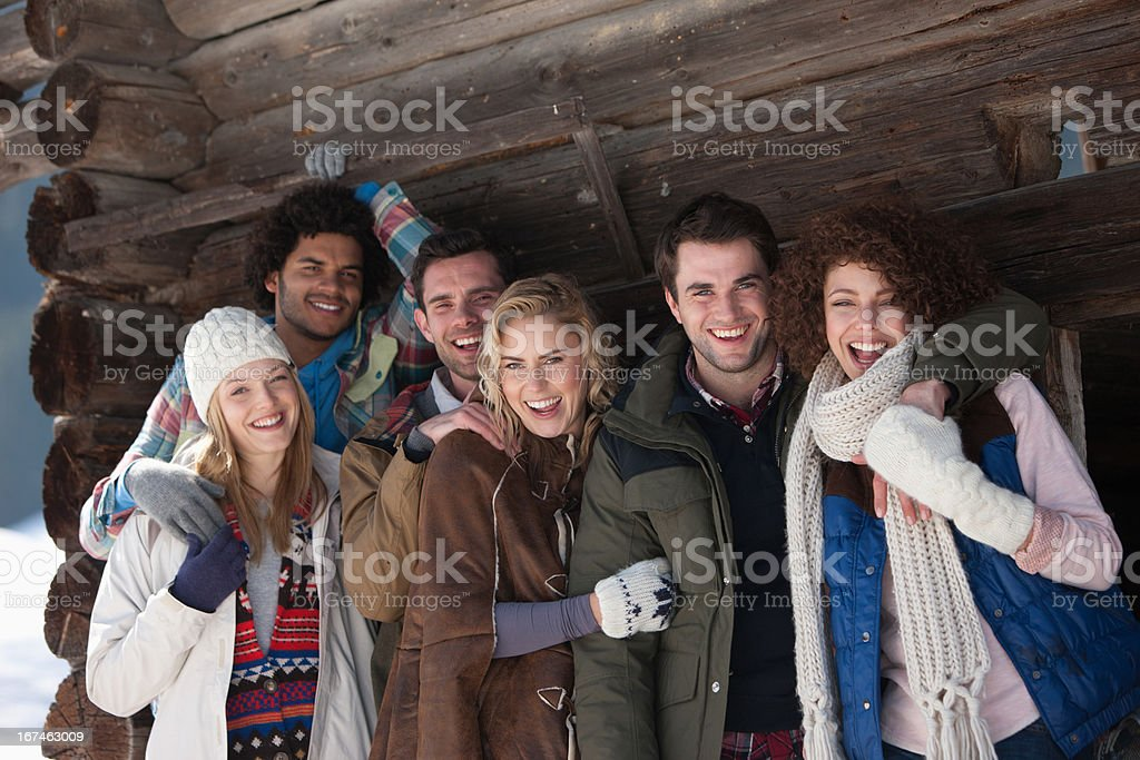 Portrait of smiling friends leaning on cabin wall royalty-free stock photo