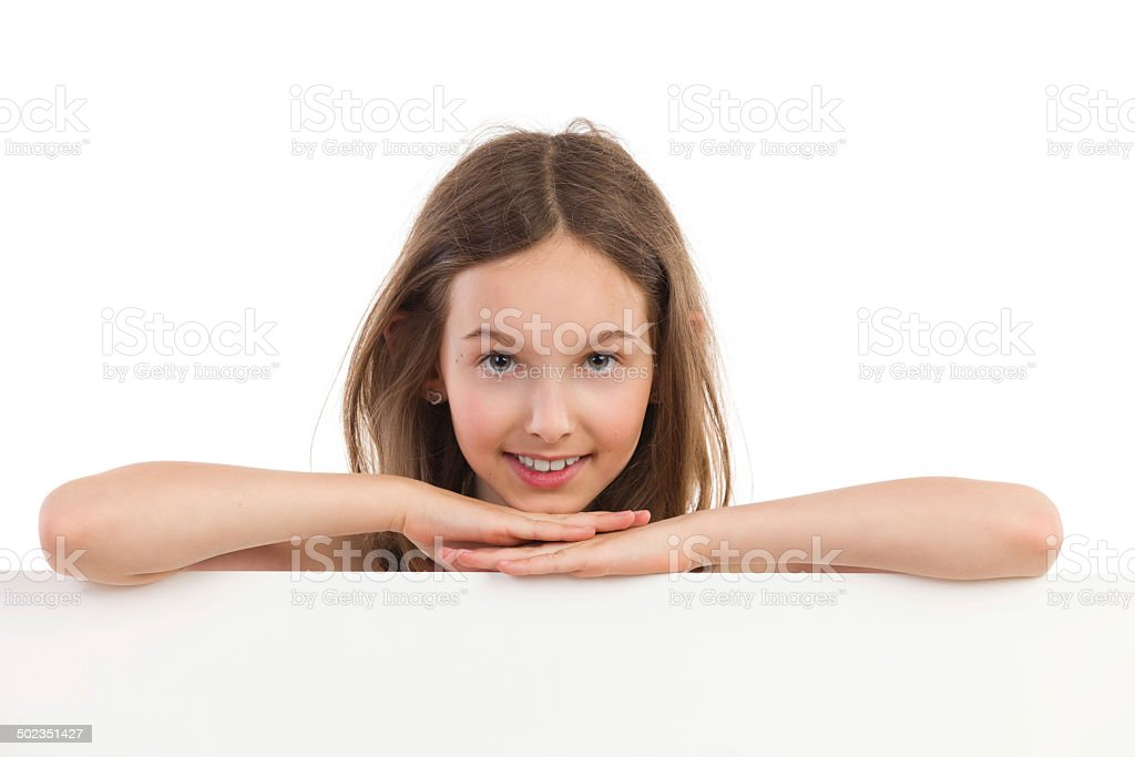 Portrait of smiling girl behind placard stock photo