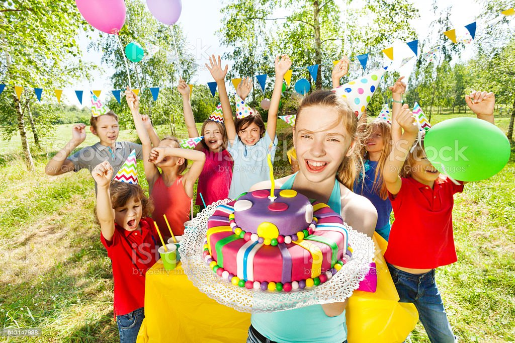Portrait of smiling girl holding birthday cake stock photo