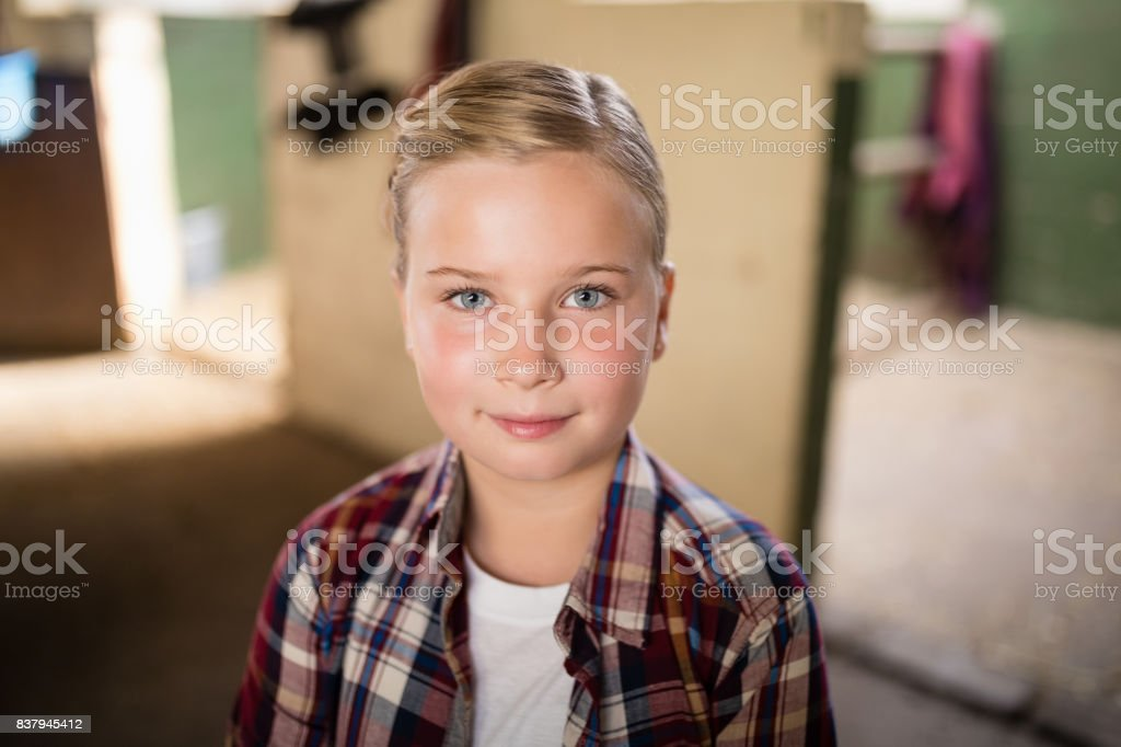 Portrait of smiling girl with blond hair stock photo