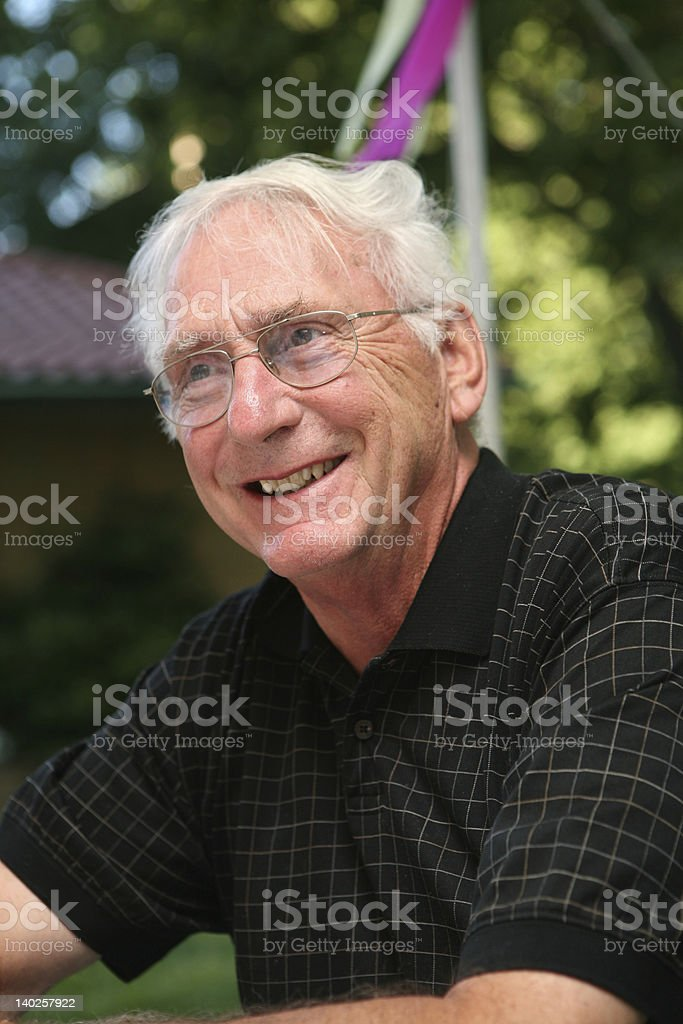 Portrait of smiling grandfather stock photo