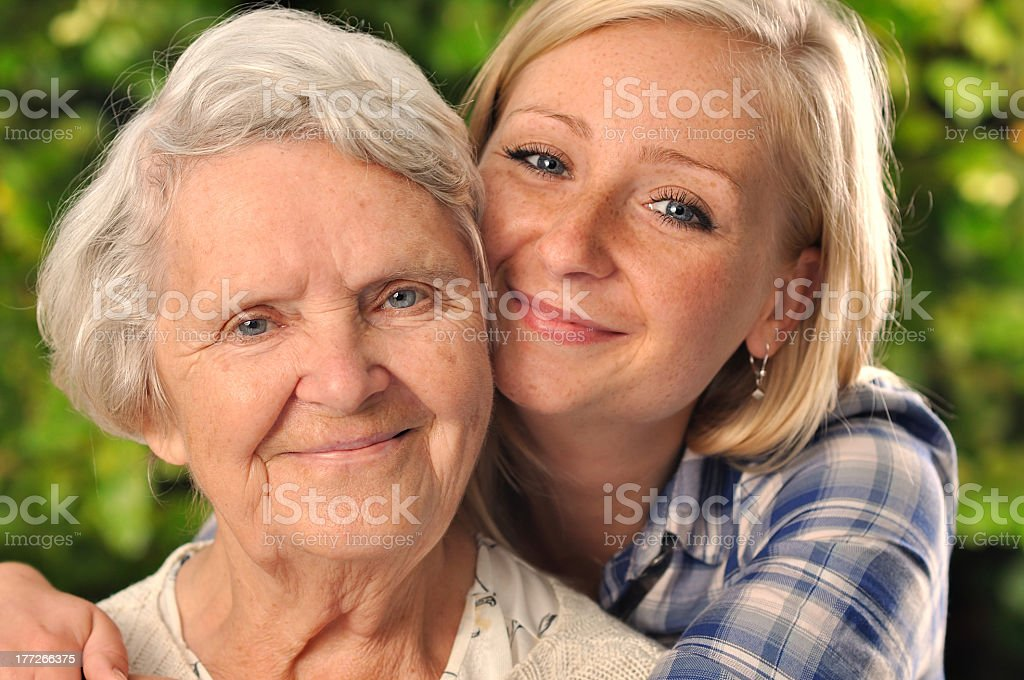 Portrait of smiling grandmother with granddaughter stock photo