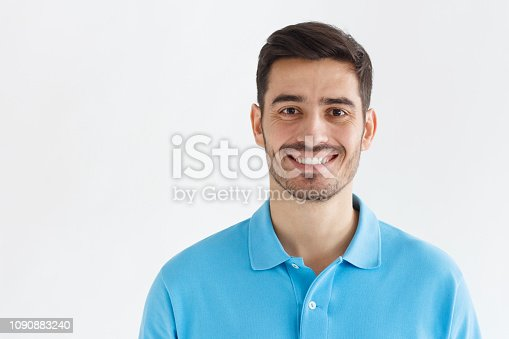 istock Portrait of smiling handsome man in blue polo shirt, isolated on grey background 1090883240
