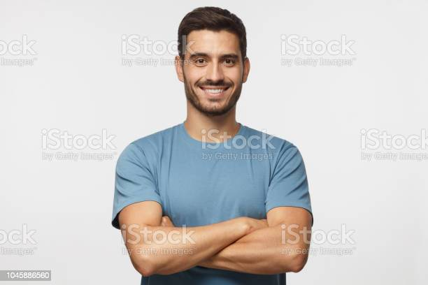 Portrait of smiling handsome man in blue tshirt standing with crossed picture id1045886560?b=1&k=6&m=1045886560&s=612x612&h=halzlirmx1kf39xjzcinnv4ssjcvqfcqt1lmy2 yv8m=