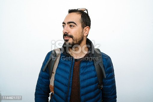 1045886560 istock photo Portrait of smiling handsome man with mustache in blue jacket looking sideways 1144621727