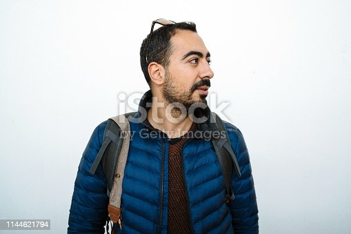 1045886560 istock photo Portrait of smiling handsome man with mustache in blue jacket looking sideways 1144621794