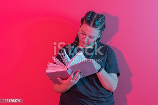 istock Portrait of smiling happy young women reading book 1171763741