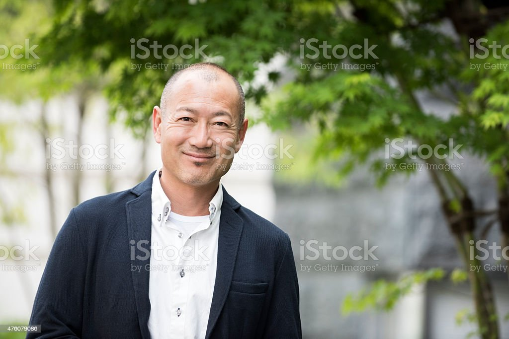 Portrait of smiling Japanese man stock photo