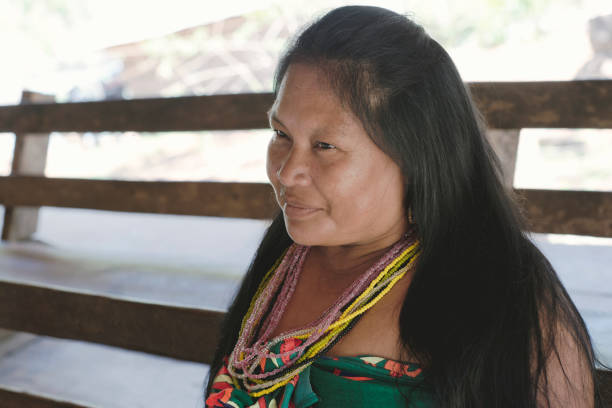 portrait of smiling katão indian woman from the embera drua village - embera indian women stock pictures, royalty-free photos & images
