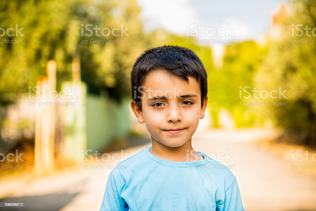 Portrait of smiling little boy looking at camera royalty-free stock photo