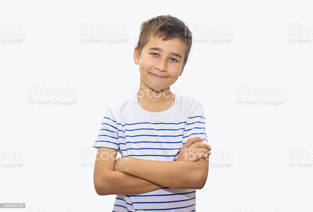 Portrait of smiling little boy over white background stock photo
