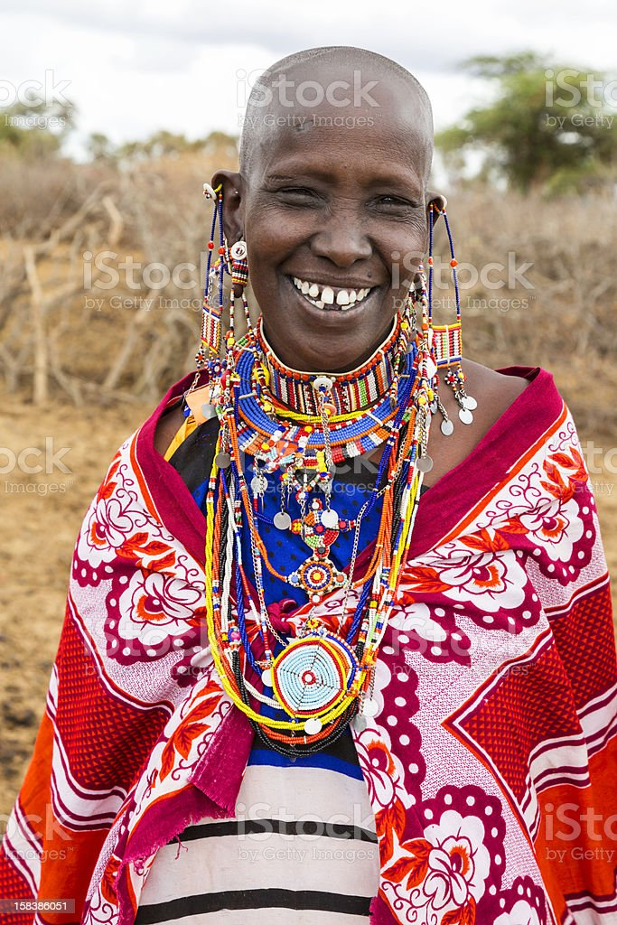 Portrait of smiling Maasai woman with elaborate traditional jewellery stock photo