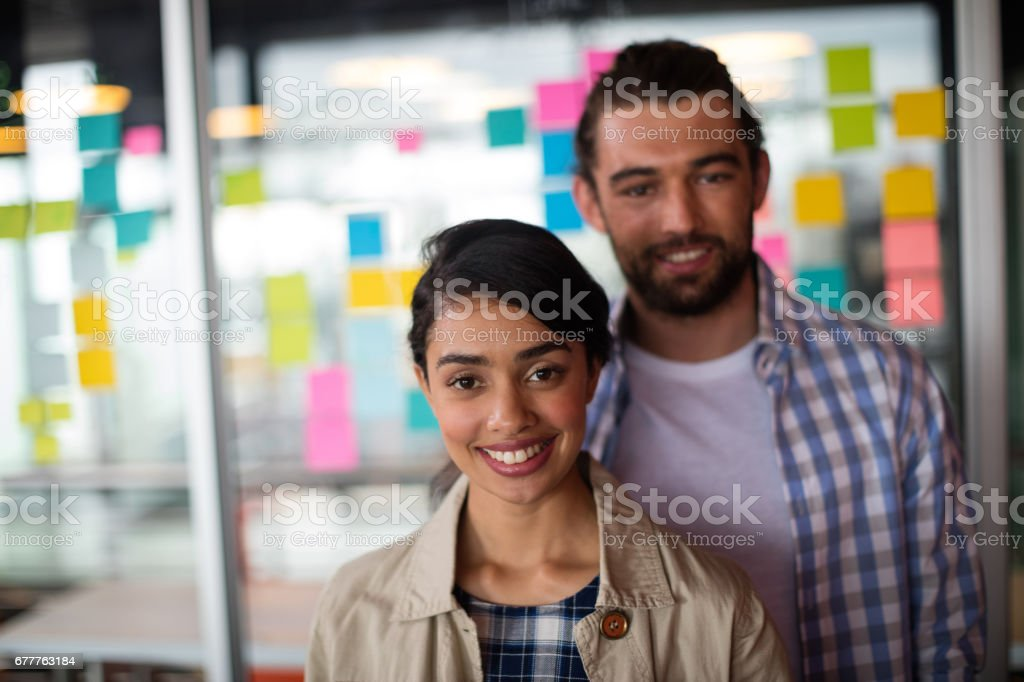 Portrait of smiling male and female executives royalty-free stock photo