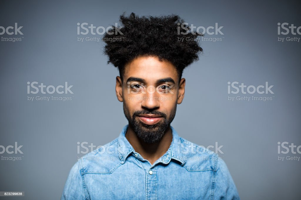 Portrait Of Smiling Man Against Gray Background stock photo