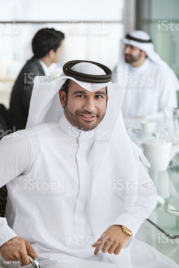 Portrait of smiling man in kaffiyeh stock photo
