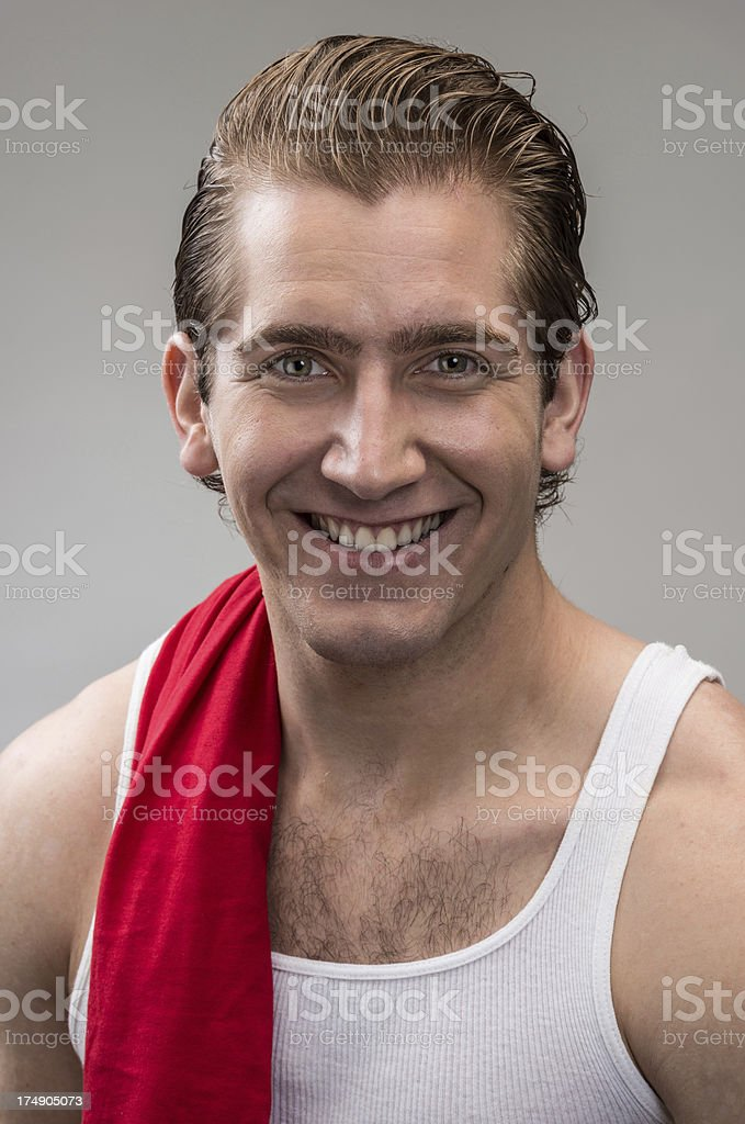 Portrait of smiling man in white tank with red towel. royalty-free stock photo