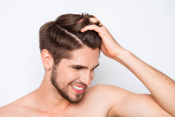 Portrait of smiling man showing his healthy hair without furfur Portrait of smiling man showing his healthy hair without furfur dandruff stock pictures, royalty-free photos & images