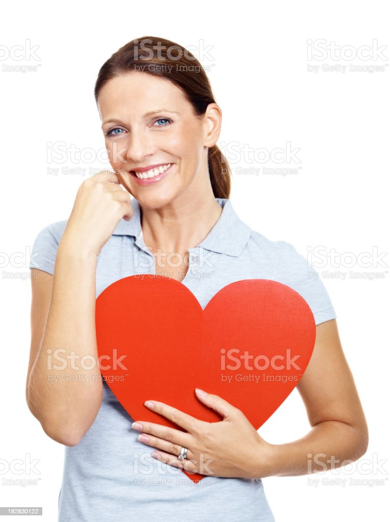 Portrait of smiling mature female holding a heart shape royalty-free stock photo