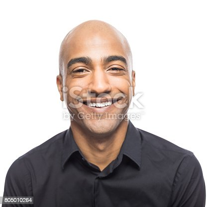Close up portrait of mature hispanic man standing smiling  white background