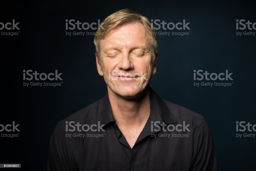 Portrait Of Smiling Mature Man With Closed Eyes royalty-free stock photo