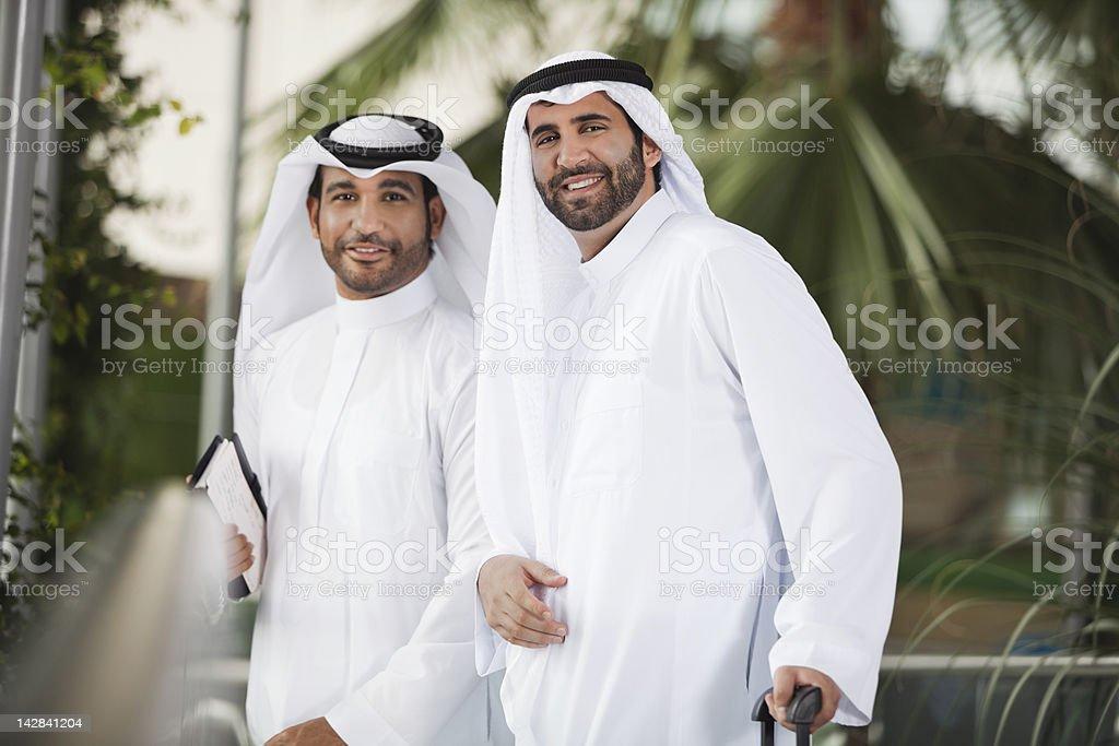 Portrait of smiling men in kaffiyeh stock photo