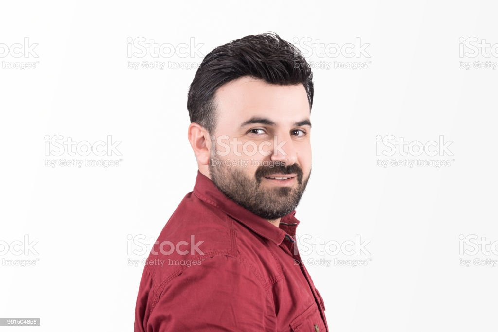 Portrait of smiling mid adult man looking at camera over white background stock photo