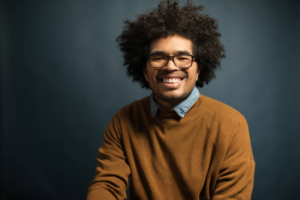 Portrait of smiling mid adult man with curly hair stock photo
